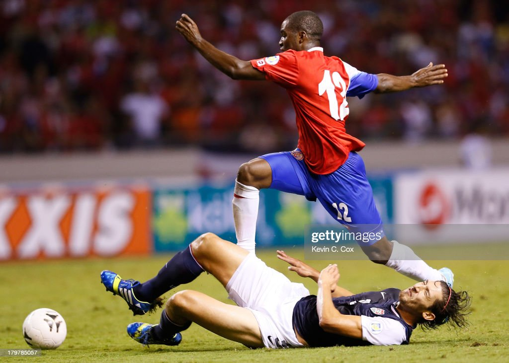 <a gi-track='captionPersonalityLinkClicked' href=/galleries/search?phrase=Omar+Gonzalez&family=editorial&specificpeople=2488485 ng-click='$event.stopPropagation()'>Omar Gonzalez</a> #3 of the United States makes a slide tackle against <a gi-track='captionPersonalityLinkClicked' href=/galleries/search?phrase=Joel+Campbell&family=editorial&specificpeople=5832048 ng-click='$event.stopPropagation()'>Joel Campbell</a> #12 during the FIFA 2014 World Cup Qualifier at Estadio Nacional on September 6, 2013 in San Jose, Costa Rica.