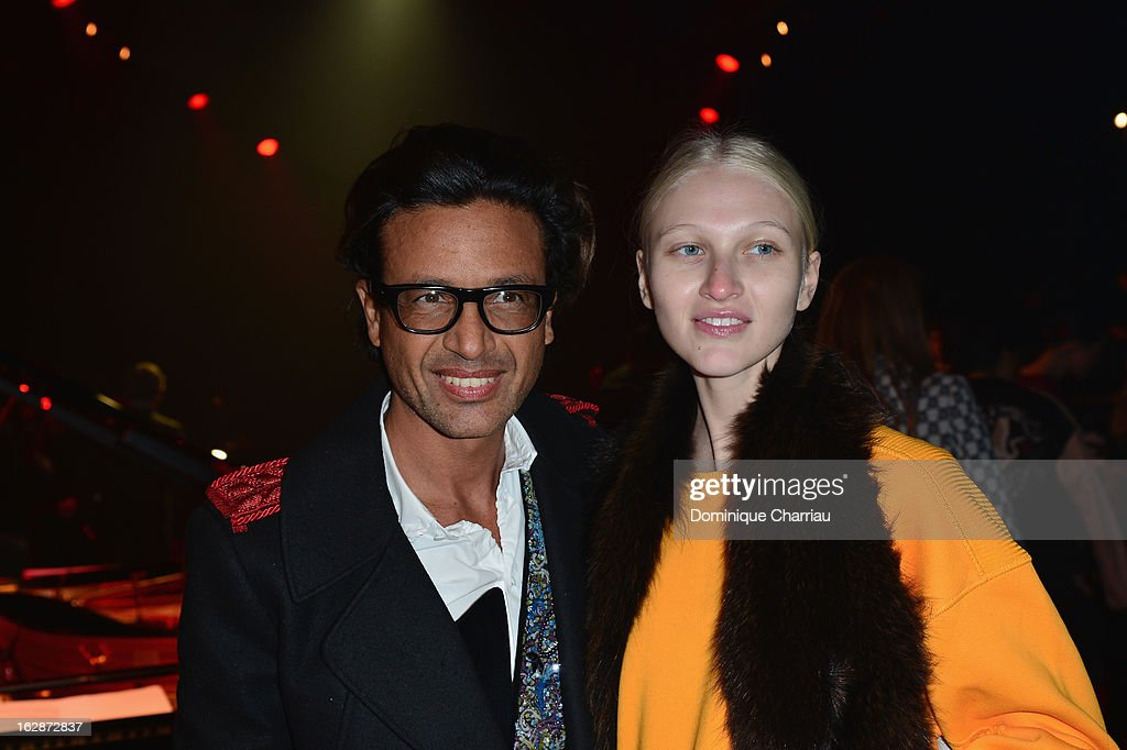<a gi-track='captionPersonalityLinkClicked' href=/galleries/search?phrase=Omar+Harfouch&family=editorial&specificpeople=606818 ng-click='$event.stopPropagation()'>Omar Harfouch</a> (L) and guest attend the Nina Ricci Fall/Winter 2013 Ready-to-Wear show as part of Paris Fashion Week on February 28, 2013 in Paris, France.