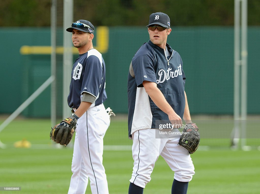 Omar Infante #4 (L) and Danny Worth #29 of the Detroit Tigers look on prior to Game Four of the American League Championship Series against the New York Yankees at Comerica Park on October 18, 2012 in Detroit, Michigan. The Tigers defeated the Yankees 8-1 and now advance to the World Series.