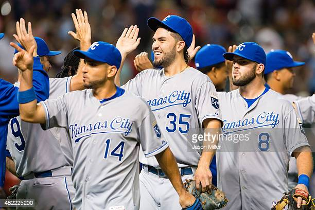 Omar Infante Eric Hosmer Mike Moustakas of the Kansas City Royals celebrate after defeating the Cleveland Indians at Progressive Field on July 28...