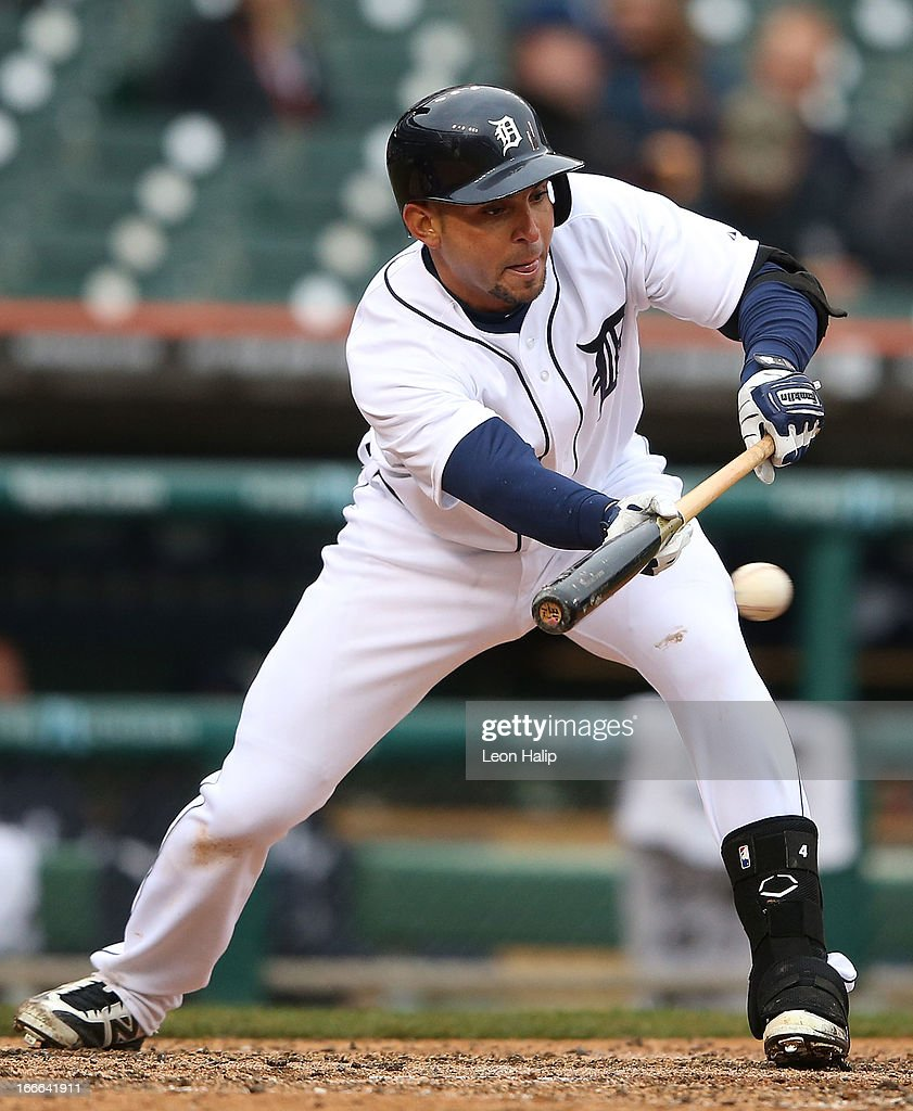 Omar Infante #4 of the Detroit Tigers bunts for a base hit during the fifth inning of the game against Toronto Blue Jays at Comerica Park on April 11, 2013 in Detroit, Michigan. The Tigers defeated the Blue Jays 11-1.