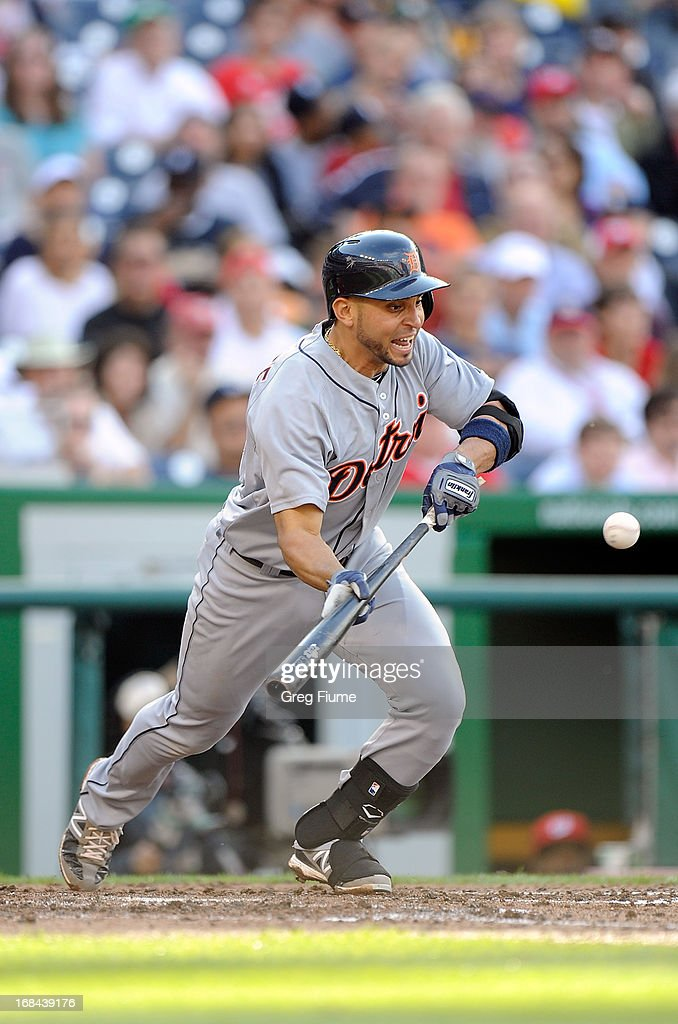 <a gi-track='captionPersonalityLinkClicked' href=/galleries/search?phrase=Omar+Infante&family=editorial&specificpeople=203255 ng-click='$event.stopPropagation()'>Omar Infante</a> #4 of the Detroit Tigers bunts for a single in the sixth inning against the Washington Nationals at Nationals Park on May 9, 2013 in Washington, DC.