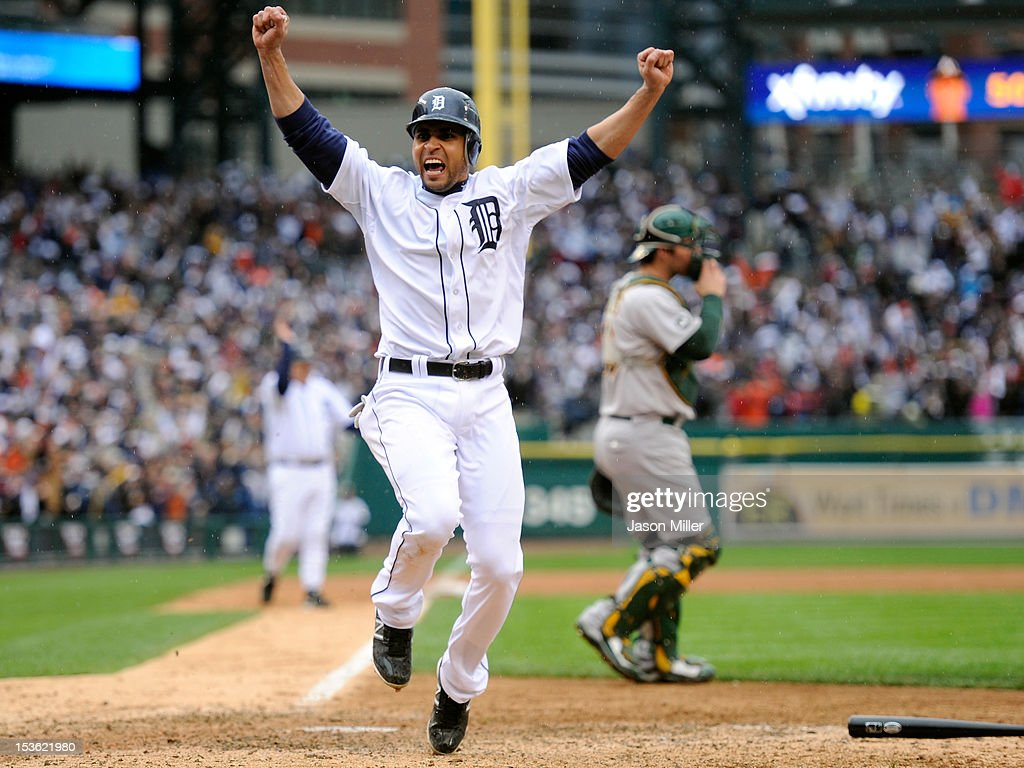 Omar Infante of the Detroit Tigers celebrates as he scores the gamewinning run on a sacrifice fly hit by Don Kelly in the bottom of the ninth inning...