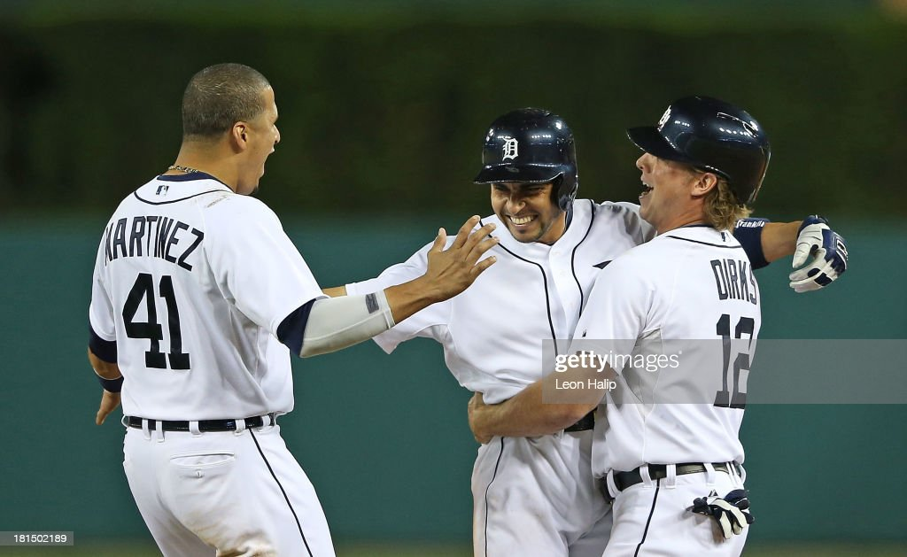 <a gi-track='captionPersonalityLinkClicked' href=/galleries/search?phrase=Omar+Infante&family=editorial&specificpeople=203255 ng-click='$event.stopPropagation()'>Omar Infante</a> #4 of the Detroit Tigers celebrates with teammates Victor Martinez #41 and <a gi-track='captionPersonalityLinkClicked' href=/galleries/search?phrase=Andy+Dirks&family=editorial&specificpeople=7511216 ng-click='$event.stopPropagation()'>Andy Dirks</a> #12 after hitting an infield single scoring Don Kelly #32 to win the game in the bottom of the 12th inning of the game against the Chicago White Sox at Comerica Park on September 21, 2013 in Detroit, Michigan. The TIgers defeated the White Sox 7-6.
