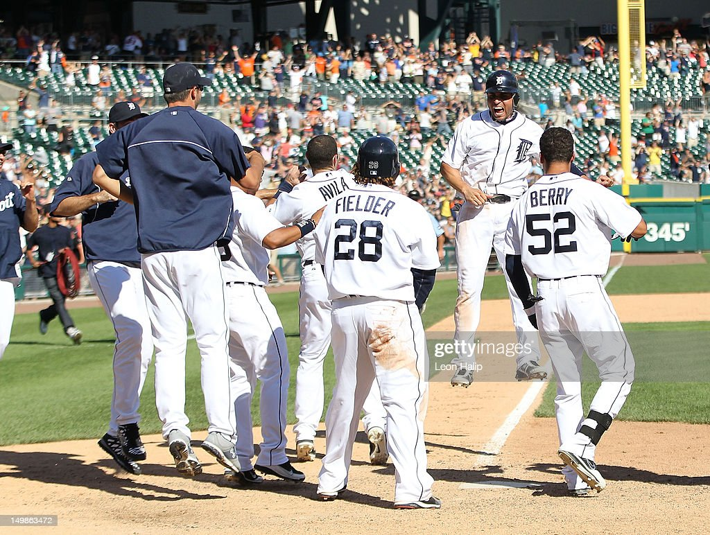 <a gi-track='captionPersonalityLinkClicked' href=/galleries/search?phrase=Omar+Infante&family=editorial&specificpeople=203255 ng-click='$event.stopPropagation()'>Omar Infante</a> #4 of the Detroit Tigers crosses home plate and celebrates <a gi-track='captionPersonalityLinkClicked' href=/galleries/search?phrase=Miguel+Cabrera&family=editorial&specificpeople=202141 ng-click='$event.stopPropagation()'>Miguel Cabrera</a> #24 two run game winning home run in the tenth inning to give the Tigers a 10-8 win over the Cleveland Indians at Comerica Park on August 5, 2012 in Detroit, Michigan. The Tigers defeated the Indians 10-8.