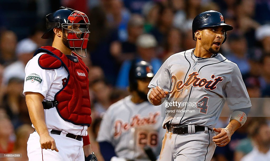 <a gi-track='captionPersonalityLinkClicked' href=/galleries/search?phrase=Omar+Infante&family=editorial&specificpeople=203255 ng-click='$event.stopPropagation()'>Omar Infante</a> #4 of the Detroit Tigers crosses home plate to score in the third inning in front of <a gi-track='captionPersonalityLinkClicked' href=/galleries/search?phrase=Jarrod+Saltalamacchia&family=editorial&specificpeople=836404 ng-click='$event.stopPropagation()'>Jarrod Saltalamacchia</a> #39 of the Boston Red Sox during the game on July 30, 2012 at Fenway Park in Boston, Massachusetts.