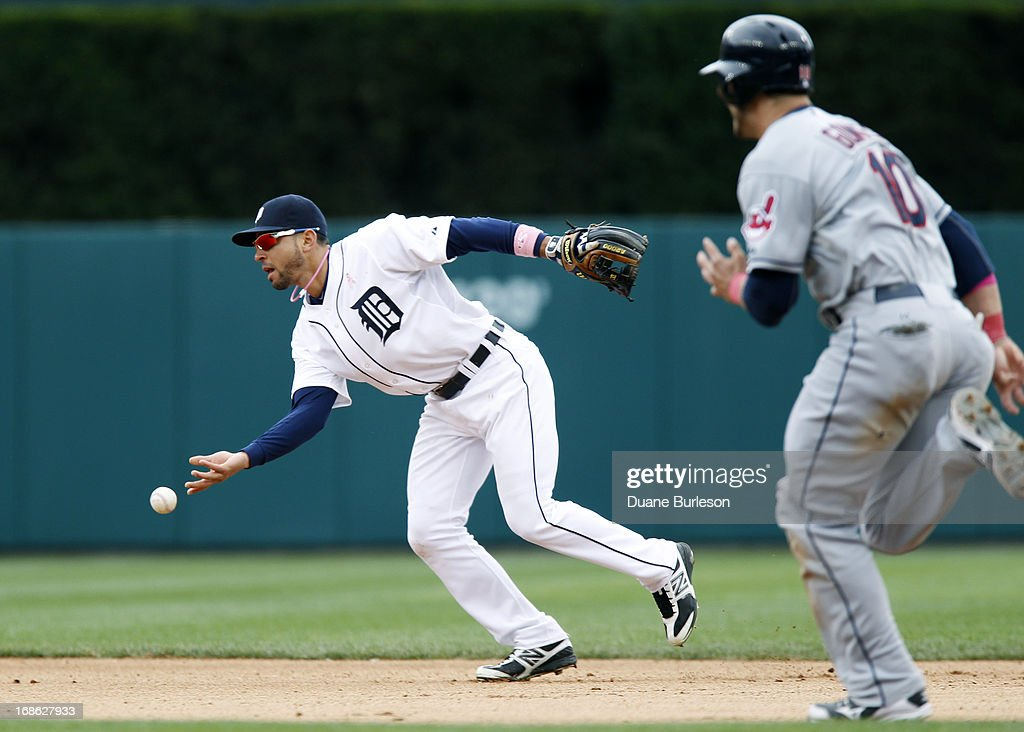 <a gi-track='captionPersonalityLinkClicked' href=/galleries/search?phrase=Omar+Infante&family=editorial&specificpeople=203255 ng-click='$event.stopPropagation()'>Omar Infante</a> #4 of the Detroit Tigers flips the ball to second base to get a force out on <a gi-track='captionPersonalityLinkClicked' href=/galleries/search?phrase=Yan+Gomes&family=editorial&specificpeople=9004037 ng-click='$event.stopPropagation()'>Yan Gomes</a> #10 of the Cleveland Indians in the seventh inning at Comerica Park on May 12, 2013 in Detroit, Michigan.