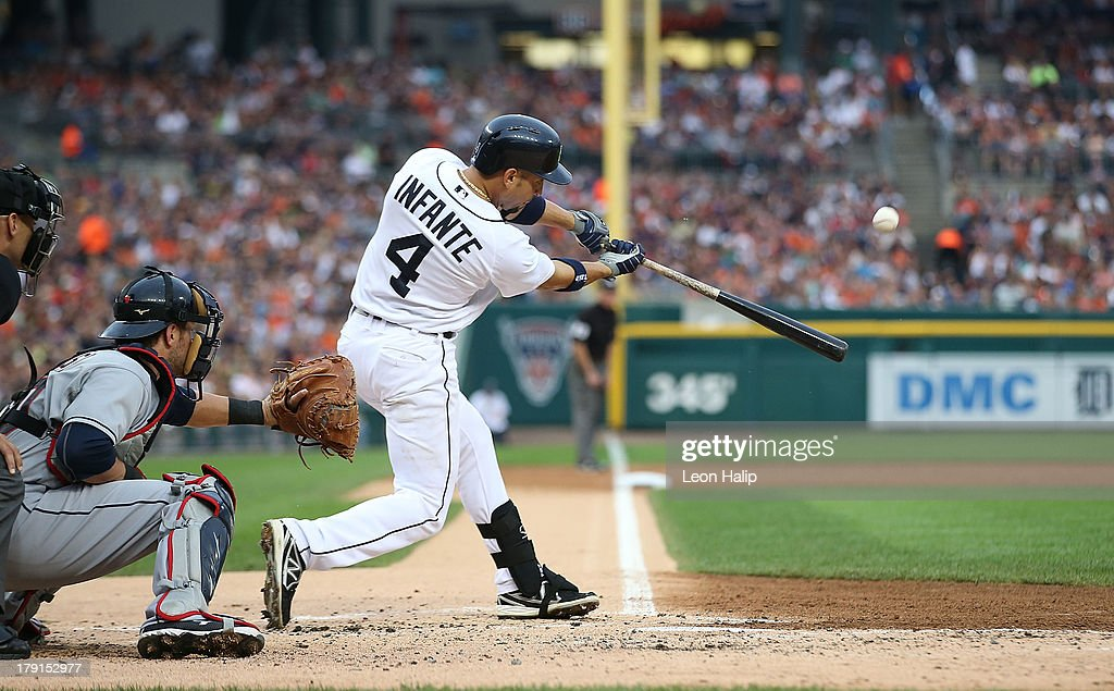 <a gi-track='captionPersonalityLinkClicked' href=/galleries/search?phrase=Omar+Infante&family=editorial&specificpeople=203255 ng-click='$event.stopPropagation()'>Omar Infante</a> #4 of the Detroit Tigers hits a three run home run in the second inning scoring Victor Martinez #41 and Matt Tuiasosopo # 18 during the game against the Cleveland Indians at Comerica Park on August 31, 2013 in Detroit, Michigan.