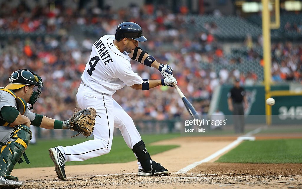 <a gi-track='captionPersonalityLinkClicked' href=/galleries/search?phrase=Omar+Infante&family=editorial&specificpeople=203255 ng-click='$event.stopPropagation()'>Omar Infante</a> #4 of the Detroit Tigers hits a two run home run scoring Andy Dirks #12 in the second inning of the game against the Oakland Athletics at Comerica Park on August 26, 2013 in Detroit, Michigan.