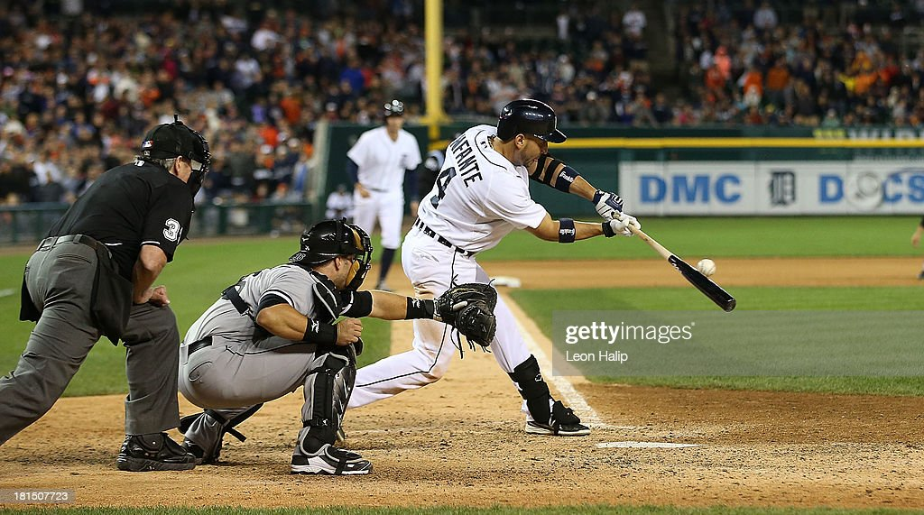 <a gi-track='captionPersonalityLinkClicked' href=/galleries/search?phrase=Omar+Infante&family=editorial&specificpeople=203255 ng-click='$event.stopPropagation()'>Omar Infante</a> #4 of the Detroit Tigers hits an infield single to win the game in the 12th inning of the game against the Chicago White Sox at Comerica Park on September 21, 2013 in Detroit, Michigan. The TIgers defeated the White Sox 7-6.