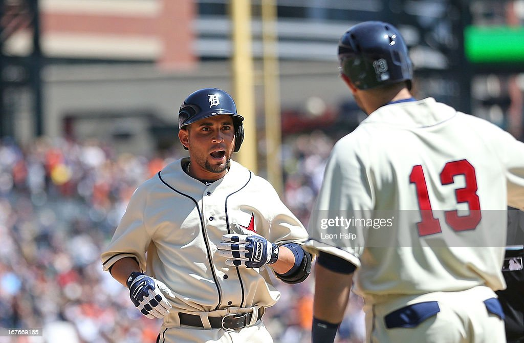 <a gi-track='captionPersonalityLinkClicked' href=/galleries/search?phrase=Omar+Infante&family=editorial&specificpeople=203255 ng-click='$event.stopPropagation()'>Omar Infante</a> #4 of the Detroit Tigers is congratulated by teammate <a gi-track='captionPersonalityLinkClicked' href=/galleries/search?phrase=Alex+Avila&family=editorial&specificpeople=5749211 ng-click='$event.stopPropagation()'>Alex Avila</a> #13 after hitting a two run home run in the fourth inning of the game against the Atlanta Braves during the game at Comerica Park on April 27, 2013 in Detroit, Michigan. The Tigers defeated the Braves 7-4.