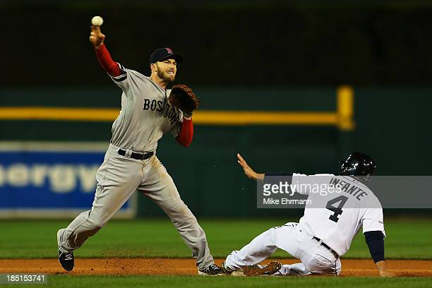 Omar Infante of the Detroit Tigers is out at second as Stephen Drew of the Boston Red Sox turns a double play on a ball hit by Brayan Pena in the...