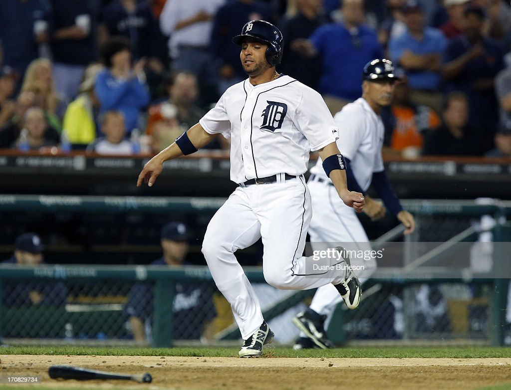 <a gi-track='captionPersonalityLinkClicked' href=/galleries/search?phrase=Omar+Infante&family=editorial&specificpeople=203255 ng-click='$event.stopPropagation()'>Omar Infante</a> #4 of the Detroit Tigers scores against the Baltimore Orioles from second base on a single by Austin Jackson in the fifth inning at Comerica Park on June 18, 2013 in Detroit, Michigan.