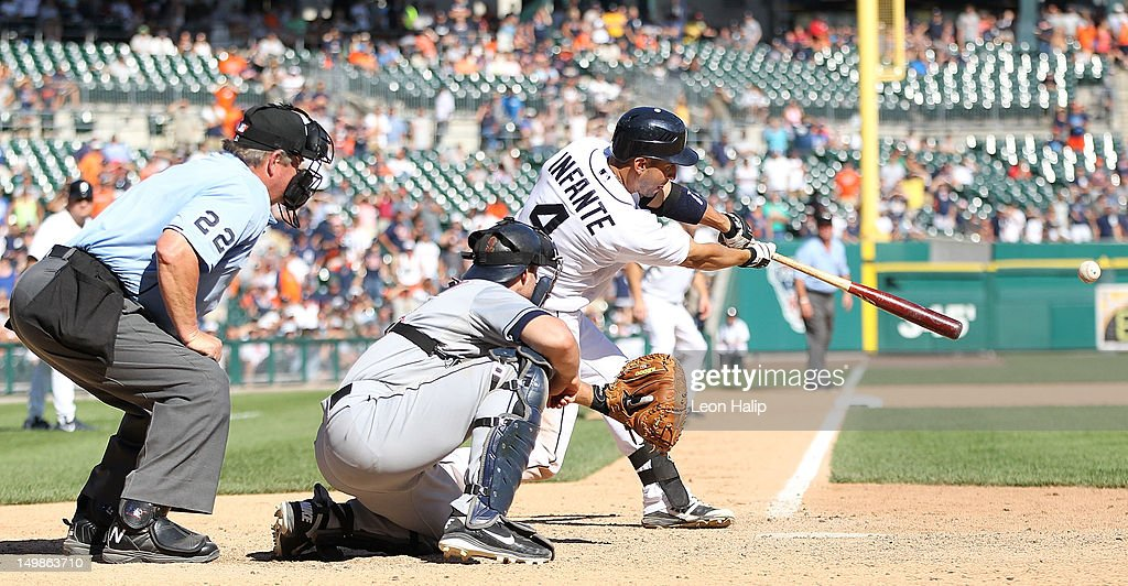 <a gi-track='captionPersonalityLinkClicked' href=/galleries/search?phrase=Omar+Infante&family=editorial&specificpeople=203255 ng-click='$event.stopPropagation()'>Omar Infante</a> #4 of the Detroit Tigers singles to center field scoring <a gi-track='captionPersonalityLinkClicked' href=/galleries/search?phrase=Andy+Dirks&family=editorial&specificpeople=7511216 ng-click='$event.stopPropagation()'>Andy Dirks</a> #12 and <a gi-track='captionPersonalityLinkClicked' href=/galleries/search?phrase=Austin+Jackson&family=editorial&specificpeople=608633 ng-click='$event.stopPropagation()'>Austin Jackson</a> #14 in the bottom of the tenth inning to tie the game against the Cleveland Indians at Comerica Park on August 5, 2012 in Detroit, Michigan. The Tigers defeated the Indians 10-8.