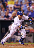 Omar Infante of the Kansas City Royals bunts fir a single in the seventh inning against the Oakland Athletics during the American League Wild Card...