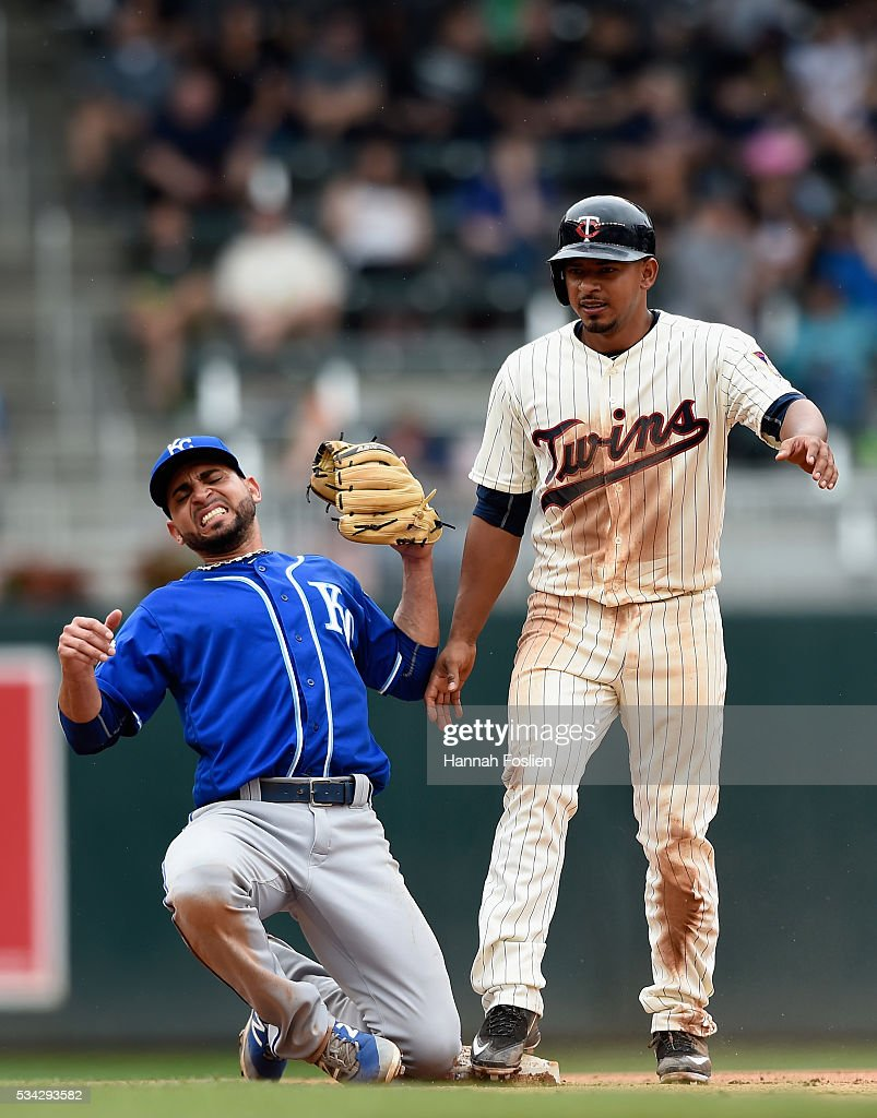 <a gi-track='captionPersonalityLinkClicked' href=/galleries/search?phrase=Omar+Infante&family=editorial&specificpeople=203255 ng-click='$event.stopPropagation()'>Omar Infante</a> #14 of the Kansas City Royals catches <a gi-track='captionPersonalityLinkClicked' href=/galleries/search?phrase=Eduardo+Escobar&family=editorial&specificpeople=7522733 ng-click='$event.stopPropagation()'>Eduardo Escobar</a> #5 of the Minnesota Twins stealing second base during the fourth inning of the game on May 25, 2016 at Target Field in Minneapolis, Minnesota. The Twins defeated the Royals 7-5.
