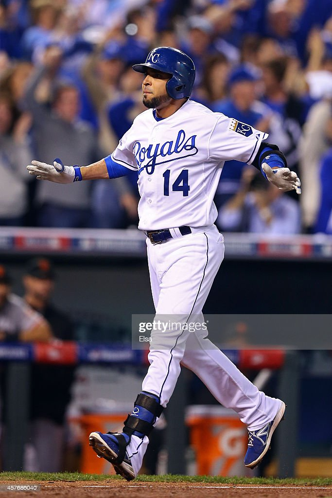 Omar Infante of the Kansas City Royals celebrates after hitting a tworun home run in the sixth inning against the San Francisco Giants during Game...