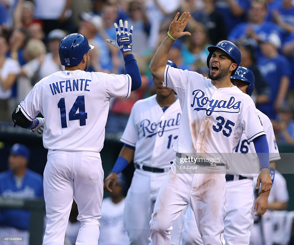<a gi-track='captionPersonalityLinkClicked' href=/galleries/search?phrase=Omar+Infante&family=editorial&specificpeople=203255 ng-click='$event.stopPropagation()'>Omar Infante</a> #14 of the Kansas City Royals celebrates his grand slam with <a gi-track='captionPersonalityLinkClicked' href=/galleries/search?phrase=Eric+Hosmer&family=editorial&specificpeople=7091345 ng-click='$event.stopPropagation()'>Eric Hosmer</a> in the third inning during a game against the Los Angeles Angels of Anaheim at Kauffman Stadium on June 27, 2014 in Kansas City, Missouri.