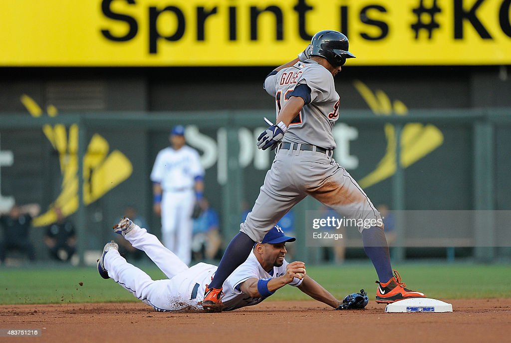 Omar Infante of the Kansas City Royals dives as he tries to tag out Anthony Gose of the Detroit Tigers as advances on a Jose Iglesias hit ball in the...