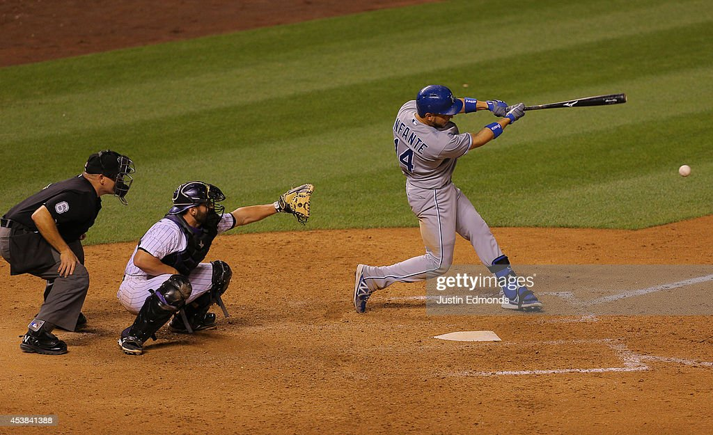 <a gi-track='captionPersonalityLinkClicked' href=/galleries/search?phrase=Omar+Infante&family=editorial&specificpeople=203255 ng-click='$event.stopPropagation()'>Omar Infante</a> #14 of the Kansas City Royals hits a two-run double during the eighth inning as catcher <a gi-track='captionPersonalityLinkClicked' href=/galleries/search?phrase=Michael+McKenry&family=editorial&specificpeople=4949028 ng-click='$event.stopPropagation()'>Michael McKenry</a> #8 of the Colorado Rockies and home plate umpire Mark Carlson look on at Coors Field on August 19, 2014 in Denver, Colorado. The Royals defeated the Rockies 7-4.