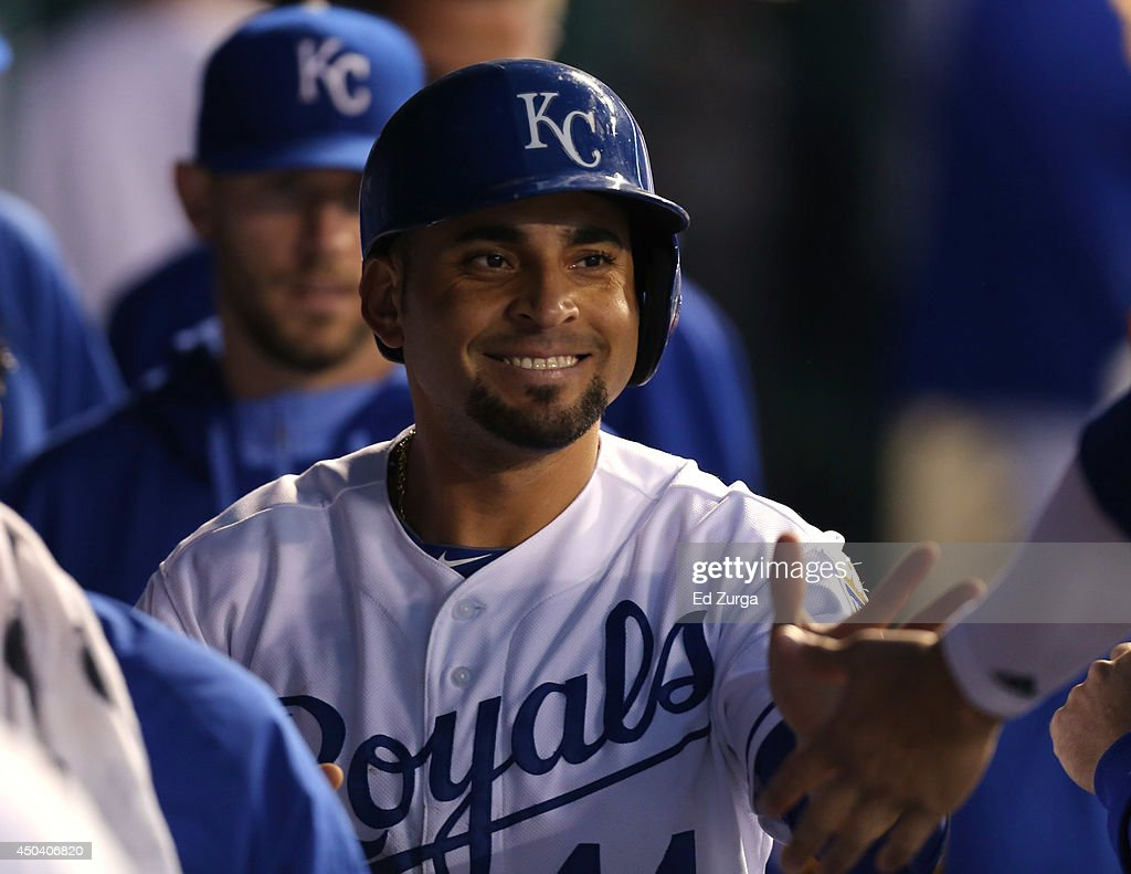 Omar Infante #14 of the Kansas City Royals is congratulated by teammates after scoring on an Eric Hosmer two-run home run in the fifth inning against the Cleveland Indians at Kauffman Stadium on June 10, 2014 in Kansas City, Missouri.