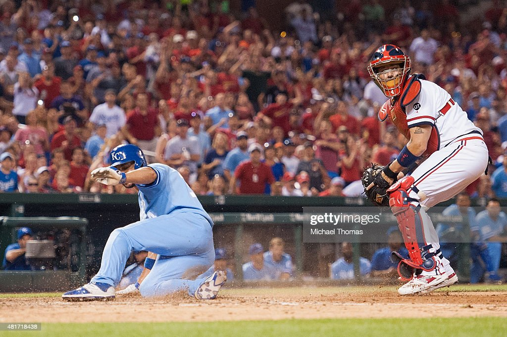 Omar Infante of the Kansas City Royals is tagged out at the plate by Yadier Molina of the St Louis Cardinals in the ninth inning at Busch Stadium on...