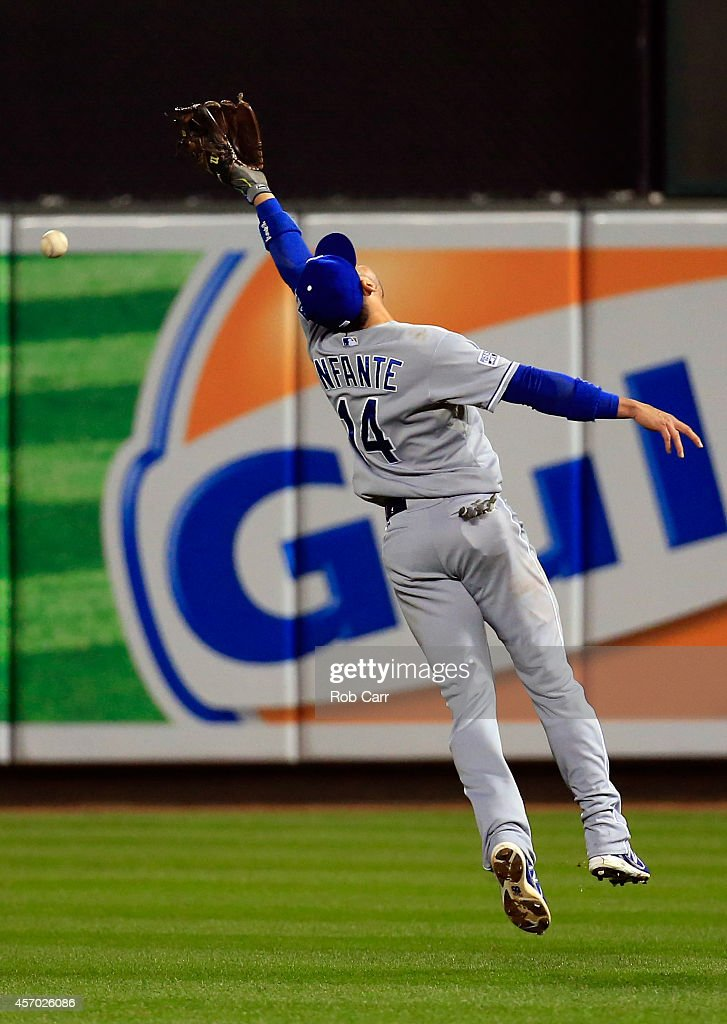 Omar Infante of the Kansas City Royals misses a catch hit by Ryan Flaherty of the Baltimore Orioles in the fourth inning during Game One of the...