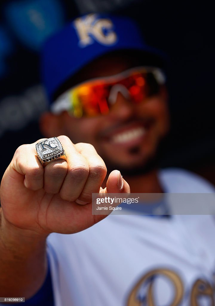 Omar Infante of the Kansas City Royals poses with his World Series Championship ring after a ring ceremony prior to the game between the Royals and...