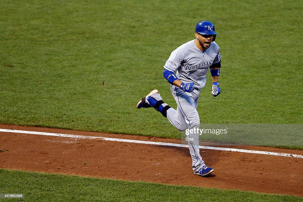 Omar Infante of the Kansas City Royals reacts after hitting a tworun single in the third inning against the San Francisco Giants during Game Four of...