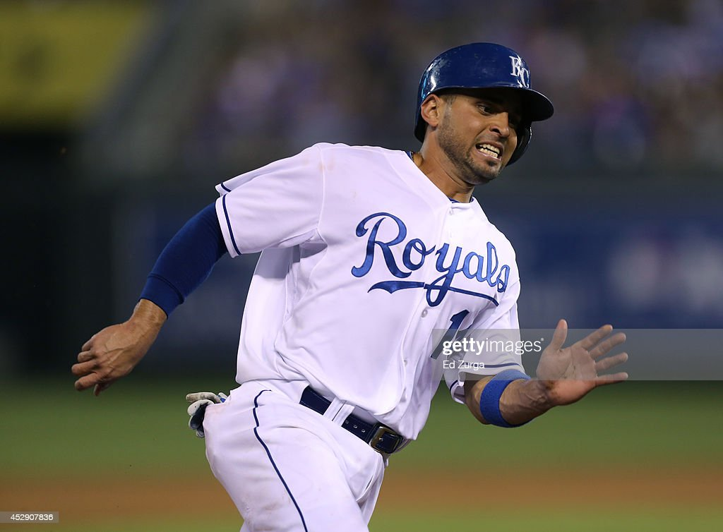 <a gi-track='captionPersonalityLinkClicked' href=/galleries/search?phrase=Omar+Infante&family=editorial&specificpeople=203255 ng-click='$event.stopPropagation()'>Omar Infante</a> #14 of the Kansas City Royals rounds third as he heads home to score on an Eric Hosmer single in the ninth inning against the Minnesota Twins at Kauffman Stadium on July 29, 2014 in Kansas City, Missouri.