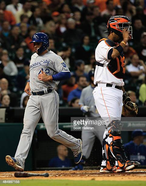 Omar Infante of the Kansas City Royals scores a run in the third inning against the Houston Astros as Carlos Corporan looks on at Minute Maid Park on...