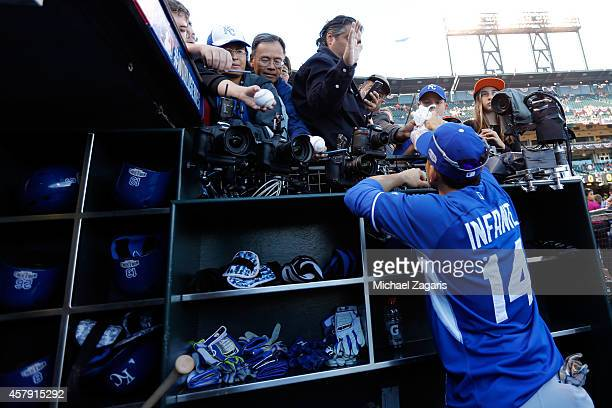 Omar Infante of the Kansas City Royals signs autographs before Game 5 of the 2014 World Series against the San Francisco Giants at ATT Park on Sunday...