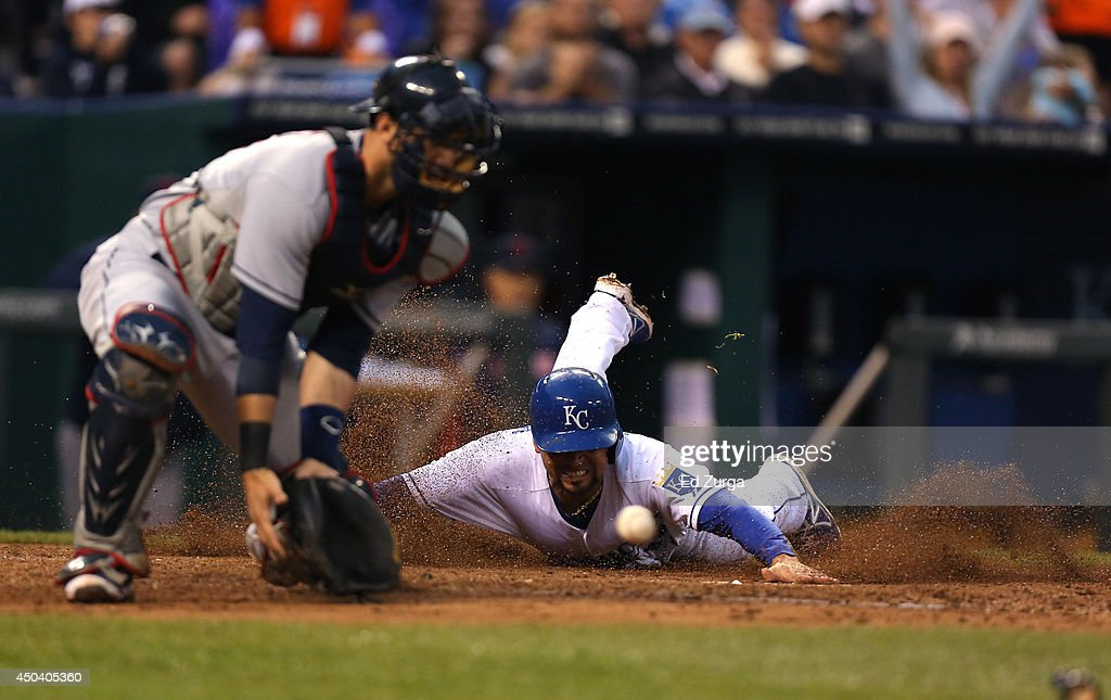 <a gi-track='captionPersonalityLinkClicked' href=/galleries/search?phrase=Omar+Infante&family=editorial&specificpeople=203255 ng-click='$event.stopPropagation()'>Omar Infante</a> #14 of the Kansas City Royals slides into home to score on a Billy Butler single as <a gi-track='captionPersonalityLinkClicked' href=/galleries/search?phrase=Yan+Gomes&family=editorial&specificpeople=9004037 ng-click='$event.stopPropagation()'>Yan Gomes</a> #10 of the Cleveland Indians fields the ball in the third inning at Kauffman Stadium on June 10, 2014 in Kansas City, Missouri.