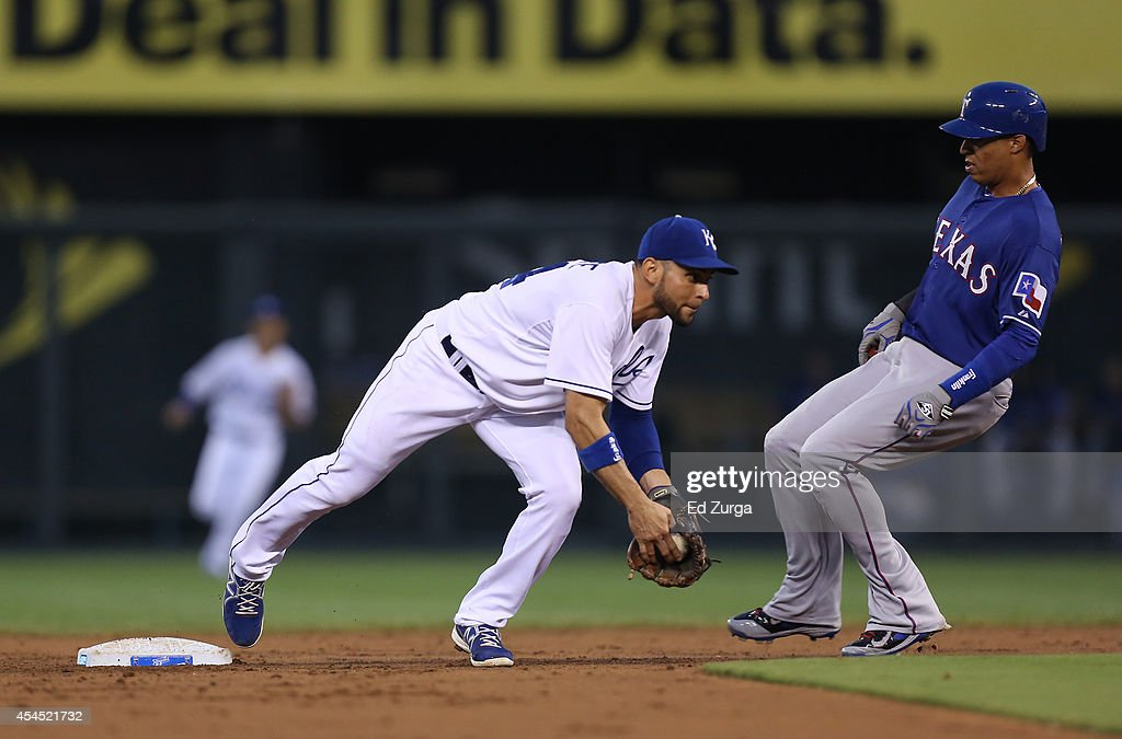 <a gi-track='captionPersonalityLinkClicked' href=/galleries/search?phrase=Omar+Infante&family=editorial&specificpeople=203255 ng-click='$event.stopPropagation()'>Omar Infante</a> #14 of the Kansas City Royals steps on second and gets the out on Leonys Martin #2 of the Texas Rangers in the third inning at Kauffman Stadium on September 2, 2014 in Kansas City, Missouri. Infante was able to throw to first to complete a double play.