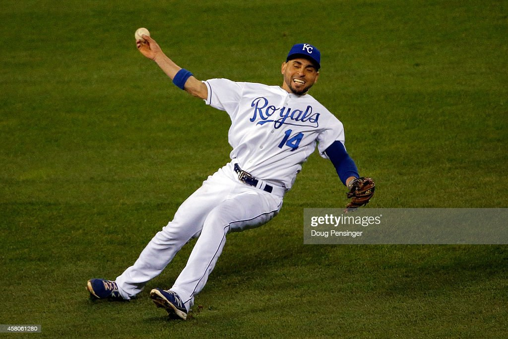 Omar Infante of the Kansas City Royals tries to make a play in the fourth inning against the San Francisco Giants during Game Seven of the 2014 World...