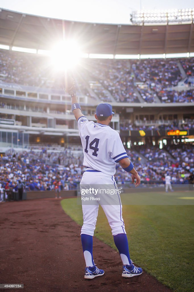 Omar Infante of the Kansas City Royals warms up before taking the field against the Cleveland Indians on August 2014 at Kauffman Stadium in Kansas...