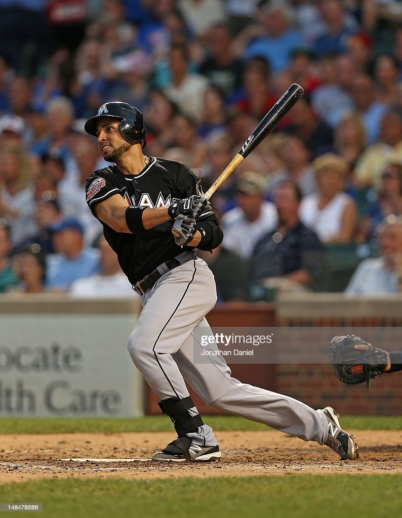 Omar Infante of the Miami Marlins hits a tworun home run in the 4th inning against the Chicago Cubs at Wrigley Field on July 17 2012 in Chicago...