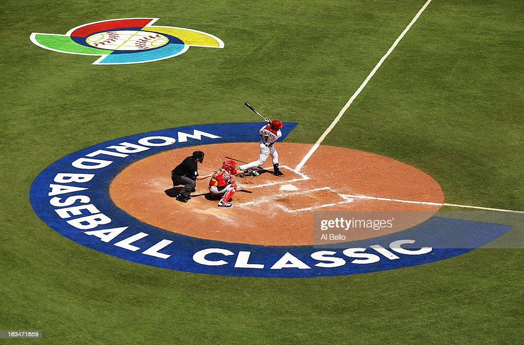 <a gi-track='captionPersonalityLinkClicked' href=/galleries/search?phrase=Omar+Infante&family=editorial&specificpeople=203255 ng-click='$event.stopPropagation()'>Omar Infante</a> #4 of Venezuela gets a hit against Spain during the first round of the World Baseball Classic at Hiram Bithorn Stadium on March 10, 2013 in San Juan, Puerto Rico.