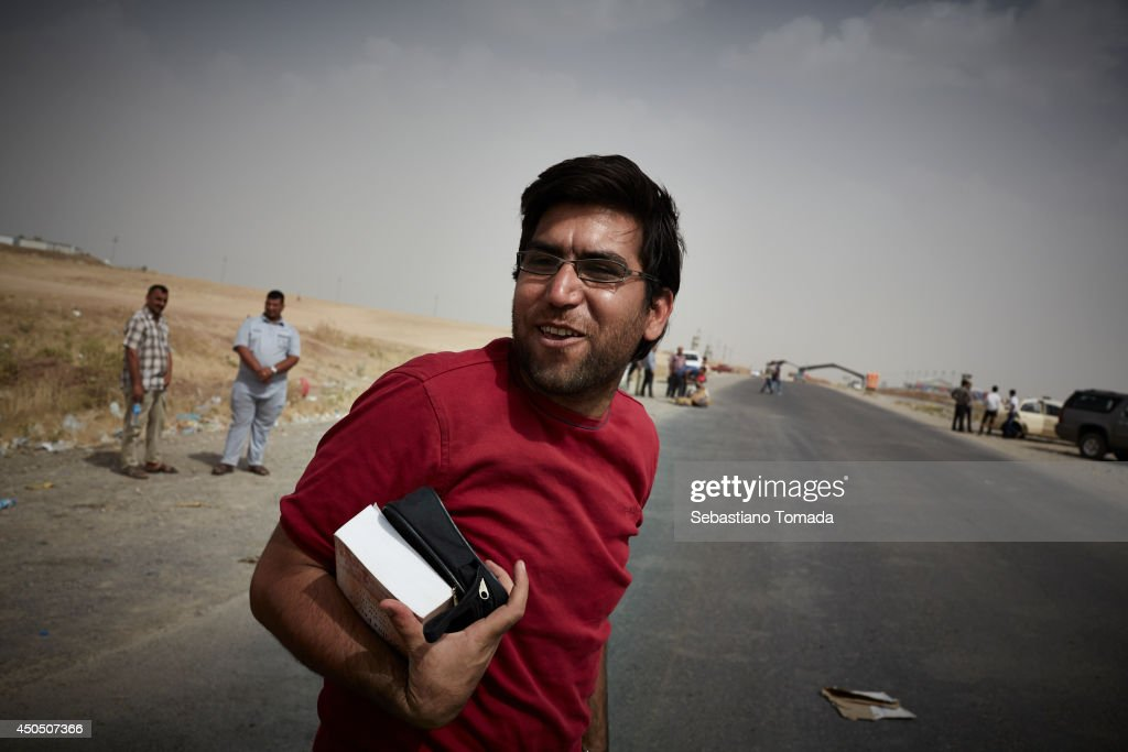 Omar Jasem, 28 years old, a Iraqi refugee from Mosul at the Kurdish checkpoint of Kalak. June 12, 2014.