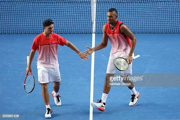 Omar Jasika and Nick Kyrgios of Australia compete in their first round doubles match against Rohan Bopanna of India and Florin Mergea of Romania...