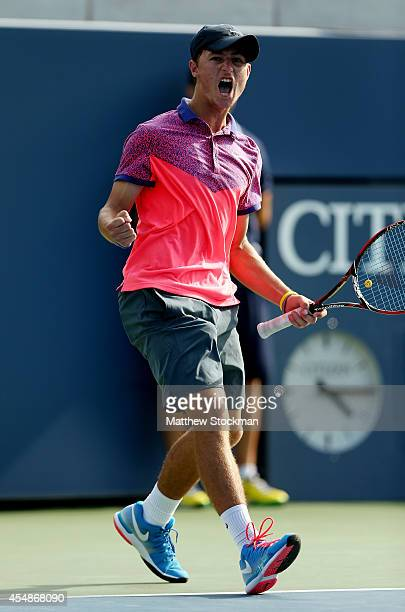 Omar Jasika of Australia celebrates after defeating Quentin Halys of France in their junior boys' singles final match on Day fourteen of the 2014 US...