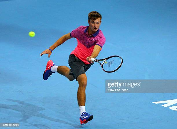 Omar Jasika of Australia in action against Rajeev Ram of USA during the Malaysian Open at Putra Stadium on September 23 2014 in Kuala Lumpur Malaysia