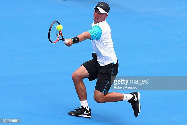 Omar Jasika of Australia plays a backhand in his match against Kei Nishikori of Japan during day two of the 2016 Kooyong Classic at Kooyong on...