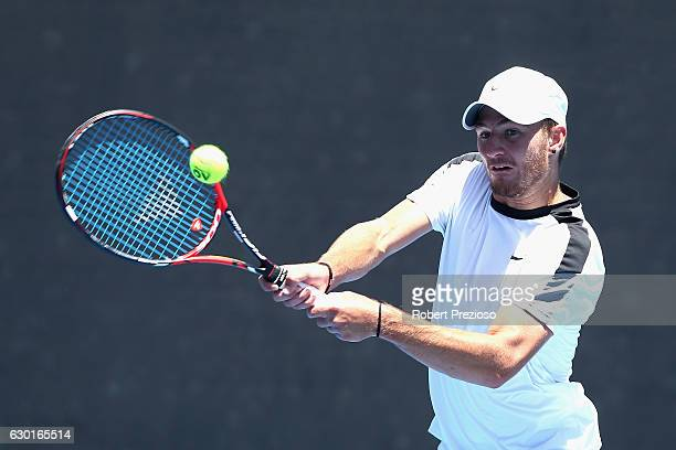 Omar Jasika of Australia plays a backhand in his mens singles match against JohnPatick Smith of Australia during the Australian Open December...