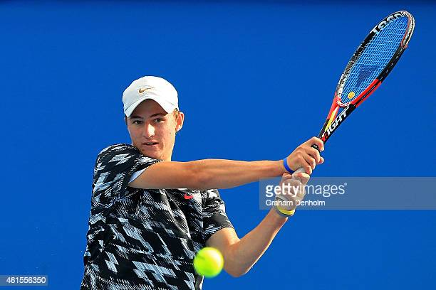 Omar Jasika of Australia plays a backhand in his qualifying match against JohnPatrick Smith of Australia for the 2015 Australian Open at Melbourne...