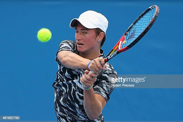 Omar Jasika of Australia plays a backhand in his qualifying match against Marius Copil of Romania for 2015 Australian Open at Melbourne Park on...