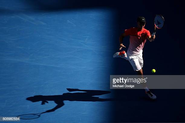 Omar Jasika of Australia plays a forehand in his first round doubles match with Nick Kyrgios of Australia against Rohan Bopanna of India and Florin...