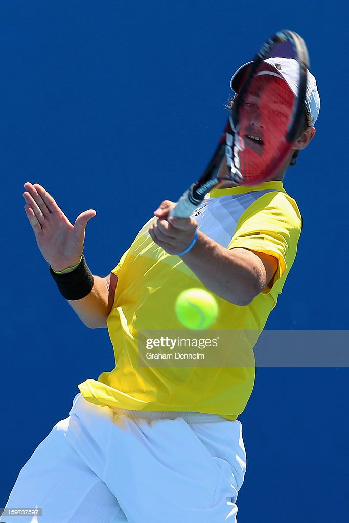 Omar Jasika of Australia plays a forehand in his first round match against Seong Chan Hong of Korea during the 2013 Australian Open Junior Championships at Melbourne Park on January 20, 2013 in Melbourne, Australia.