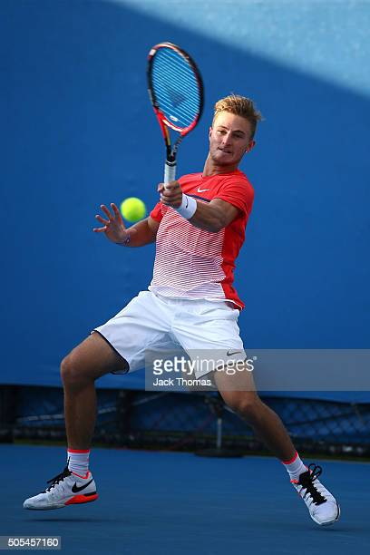 Omar Jasika of Australia plays a forehand in his first round match against Illya Marchenko of the Ukraine during day one of the 2016 Australian Open...