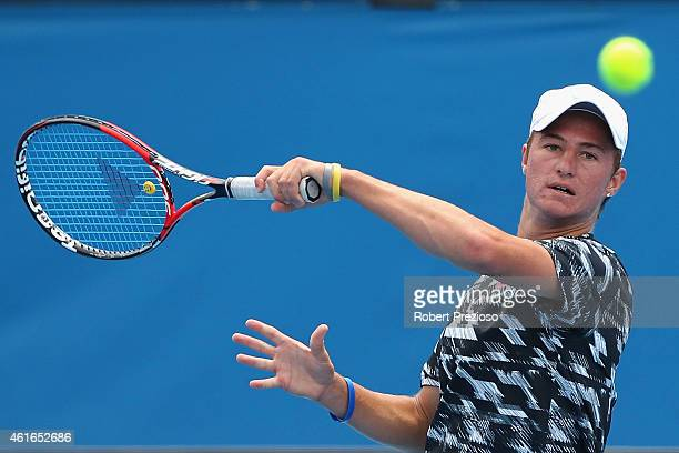 Omar Jasika of Australia plays a forehand in his qualifying match against Marius Copil of Romania for 2015 Australian Open at Melbourne Park on...